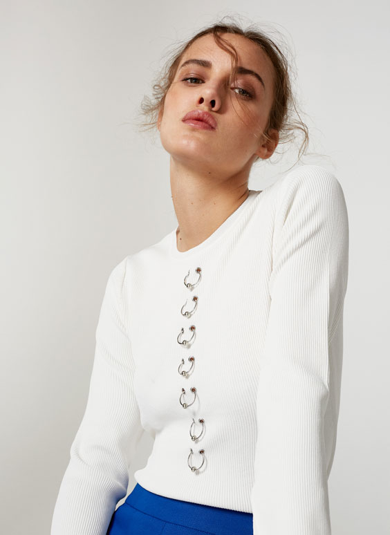 Sweater with metal ring detailing