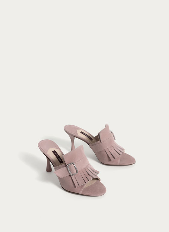 Pink suede mules with fringe