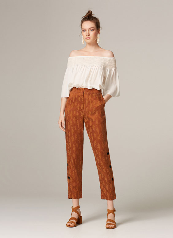 Printed trousers with press studs