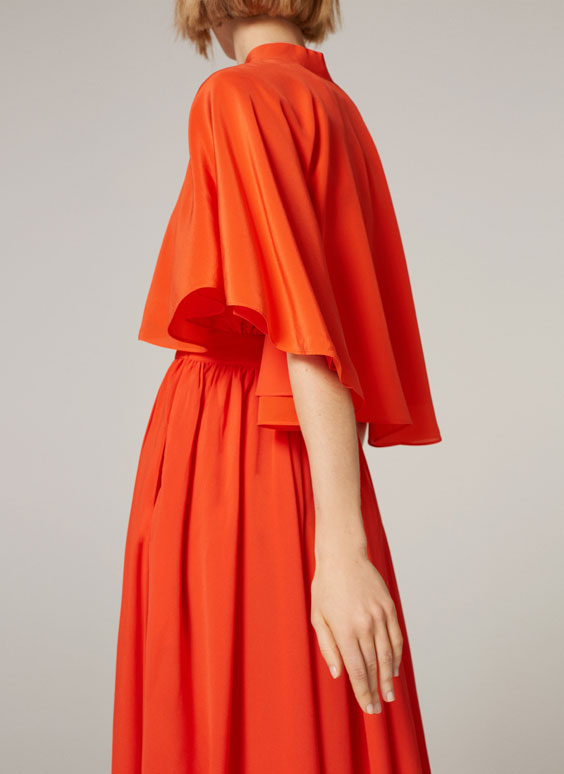 Coral cape with flowing fabric
