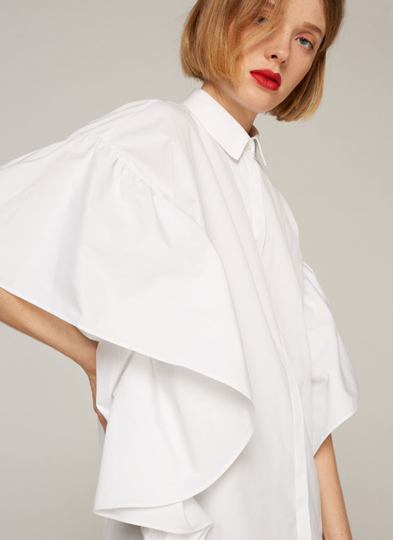Shirt with frilled batwing sleeves