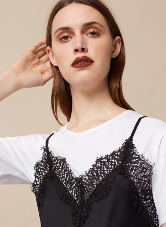 Lace top layered over T-shirt