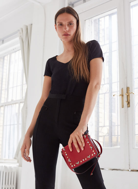 Leather crossbody bag with bees and studs