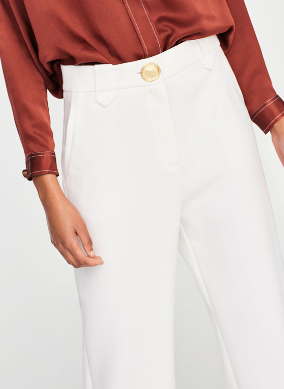 Trousers with belt loop detail