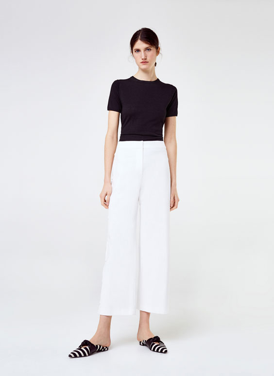 White trousers with snap buttons