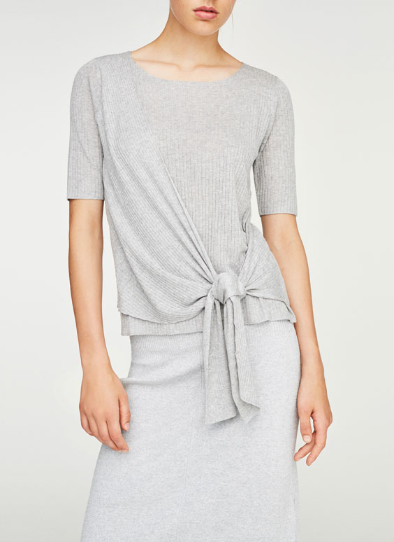 Ribbed sweater with knot