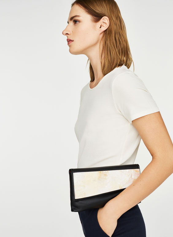 Clutch handbag with flap