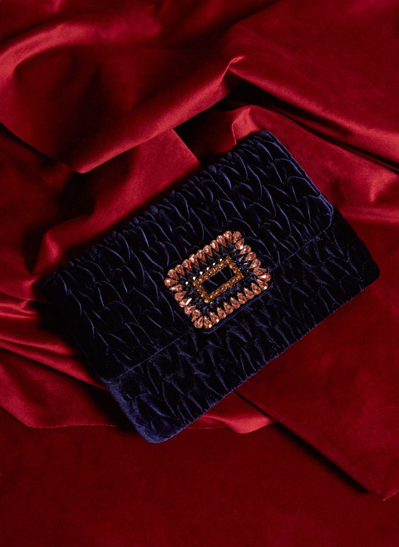 Quilted clutch with bejewelled buckle