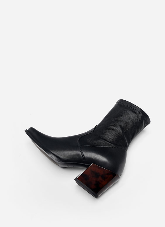 Mīkstas ādas kovboju stila puszābaki ar lāsumainu papēdi