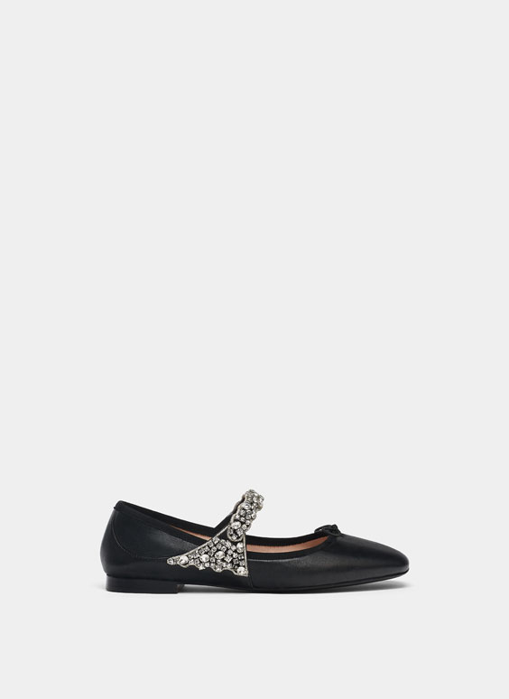 Bejewelled black ballerinas
