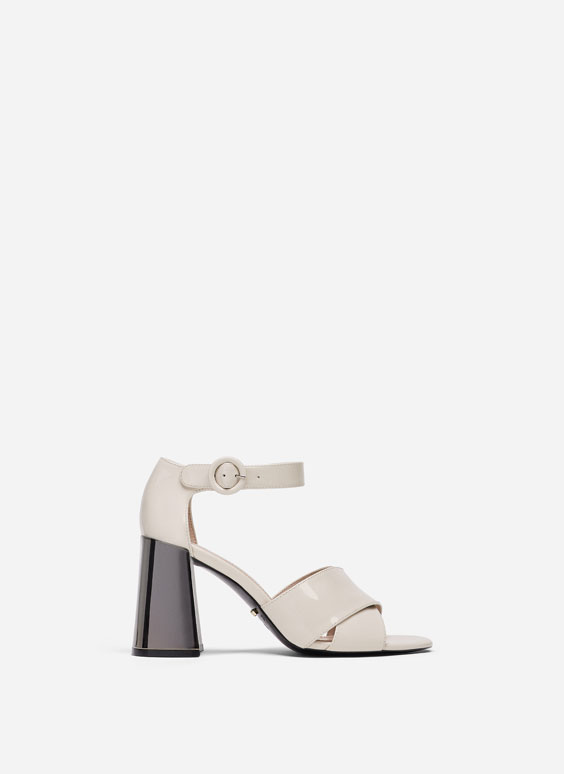 Patent sandals with chrome heel