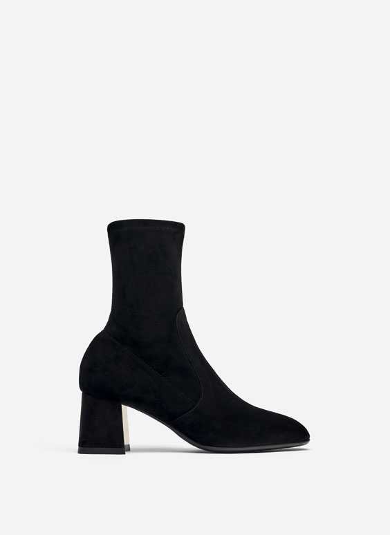 Black suede ankle boots with heel detail