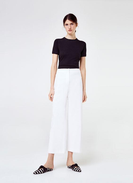 Białe spodnie z zatrzaskami