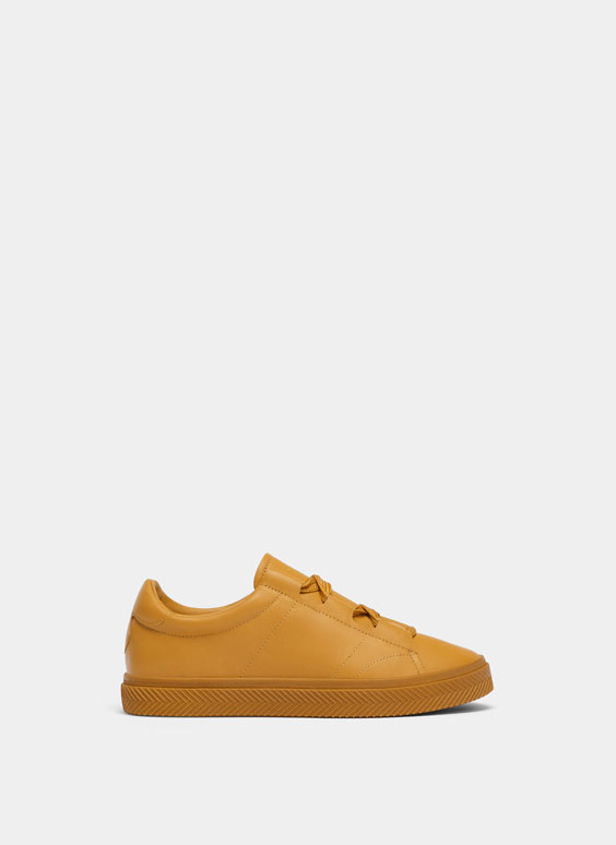 All-yellow trainers
