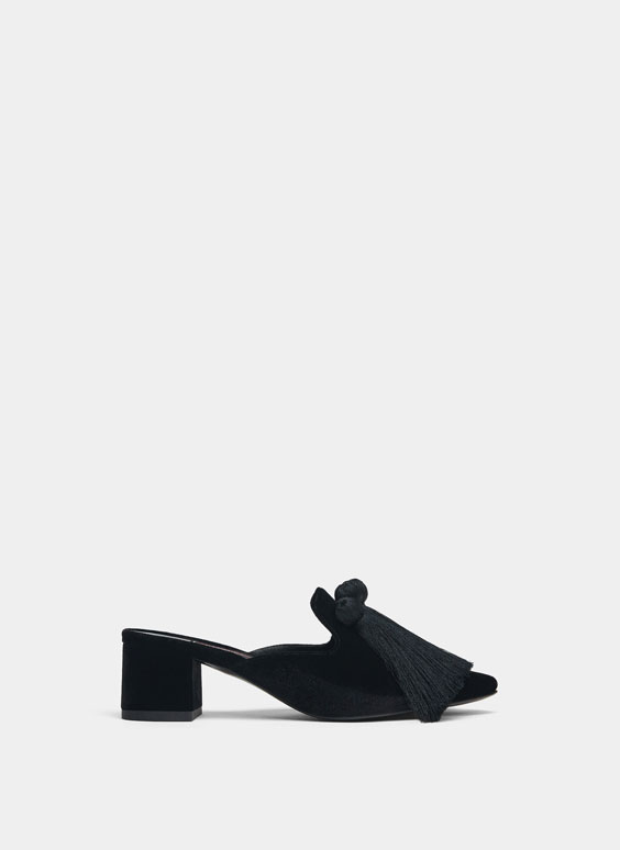 Black mules with tassels