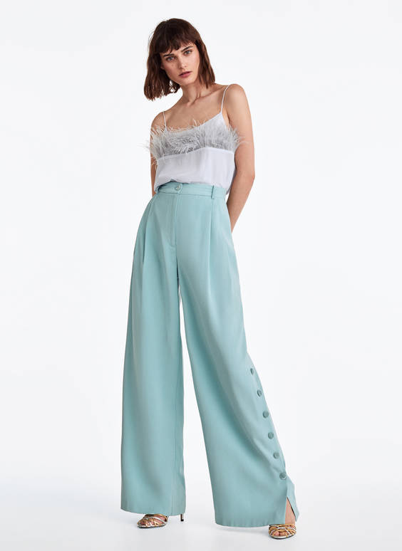 Trousers with snap buttons