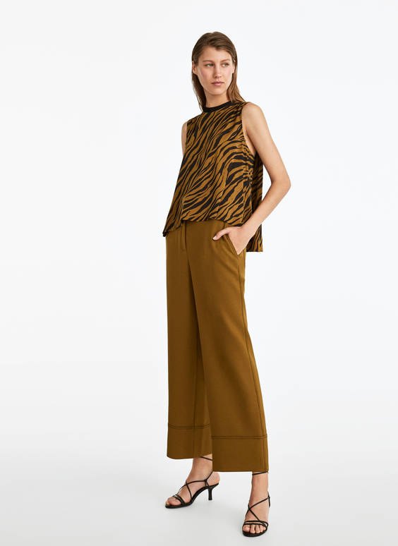 Trousers with turn-up hems