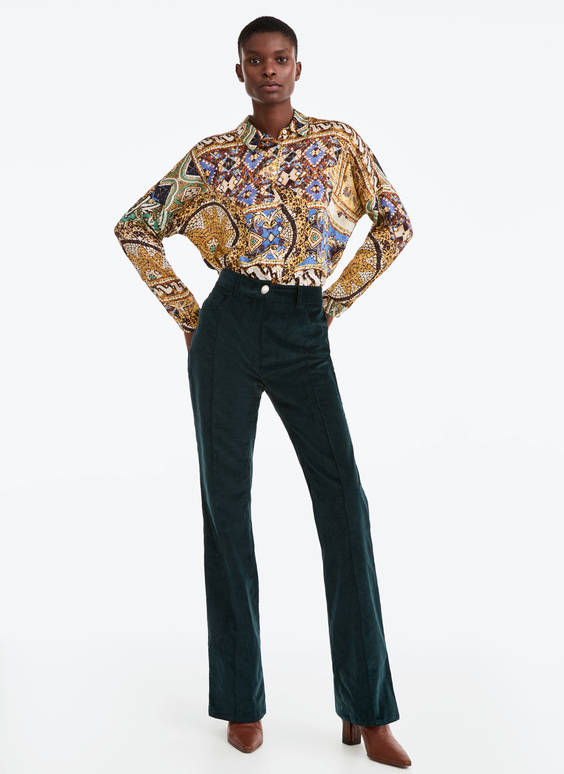 Corduroy trousers with a faux pearl button