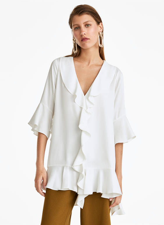 Oversized blouse with ruffles