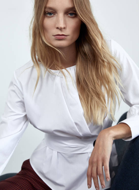 White shirt with snap-button detail