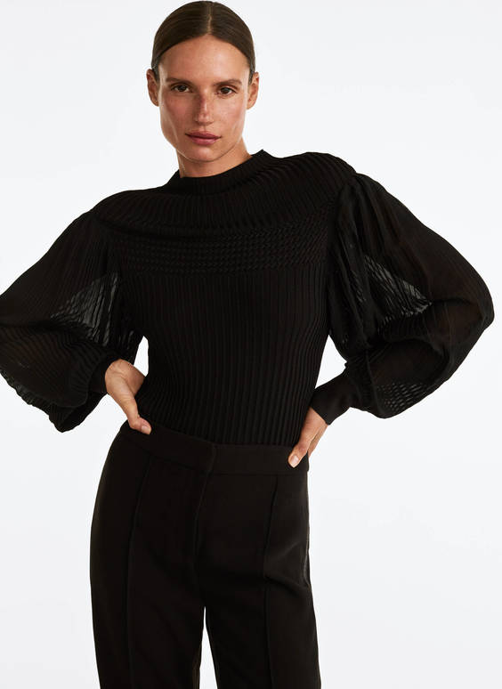 Sweater with pleated sleeves