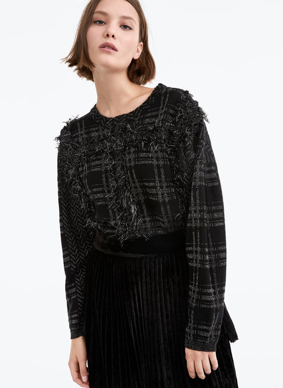 Jacquard sweater with braided appliqués
