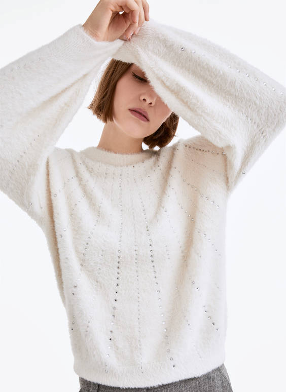 Knit sweater with shimmer appliqués
