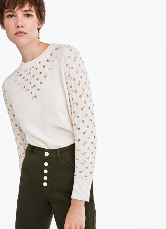 Sweater with stud appliqué