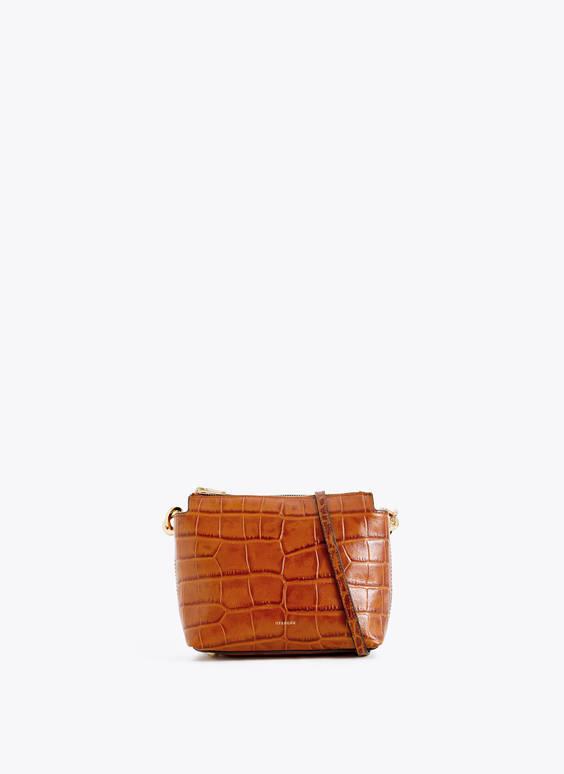 Skórzana torebka przez ramię ze złotymi nitami