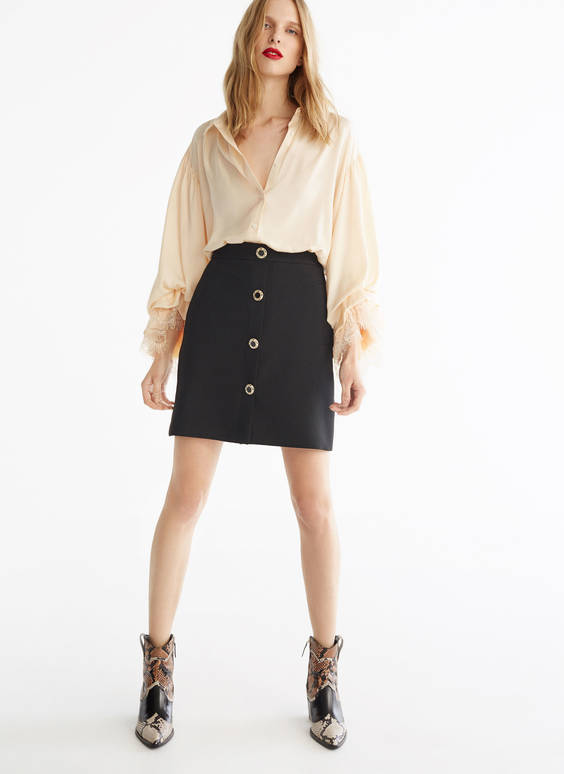 Mini skirt with embellished buttons