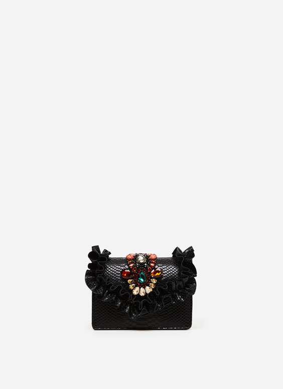 Bejewelled bag with ruffle trim