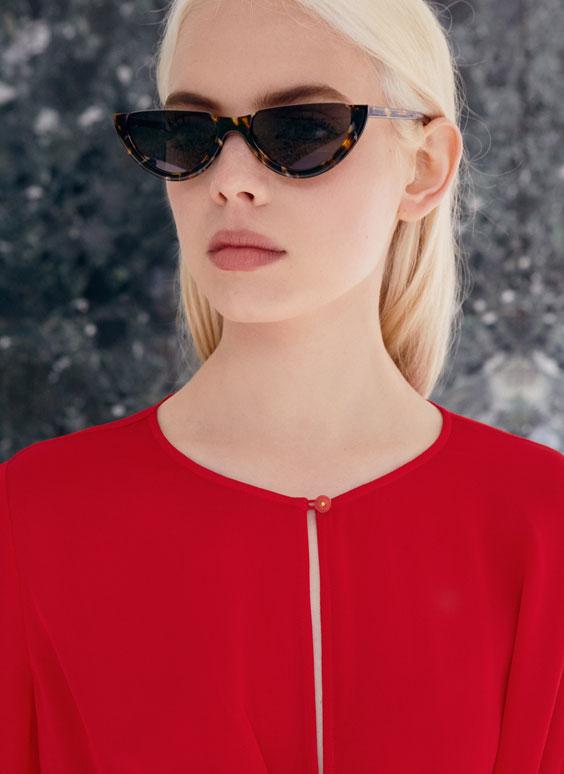 Tortoiseshell half-moon sunglasses