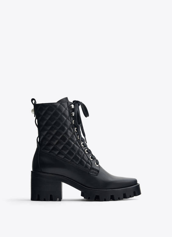 Track sole heeled buckled ankle boots