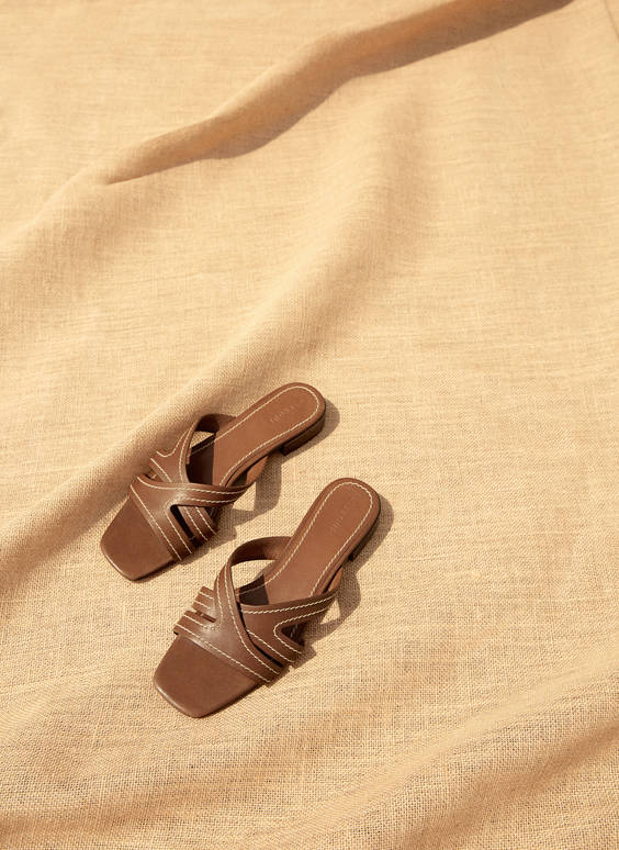 Leather slides with criss-crossed straps