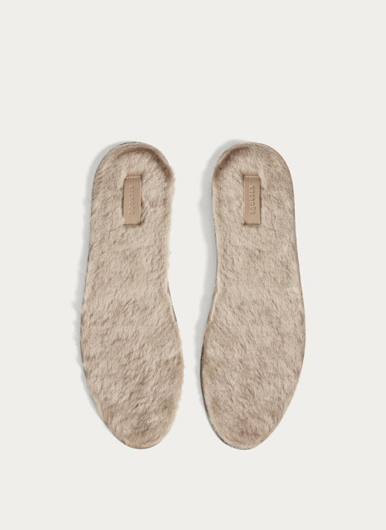 Beige furry insoles