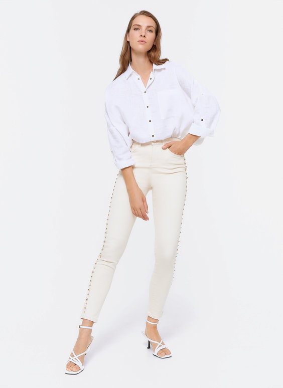 Trousers with side studs