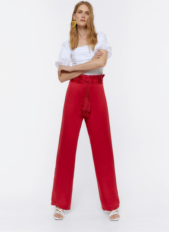 Flowing trousers with tassels