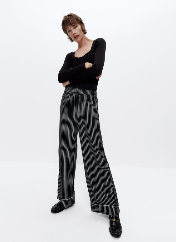 IN/OUT striped trousers