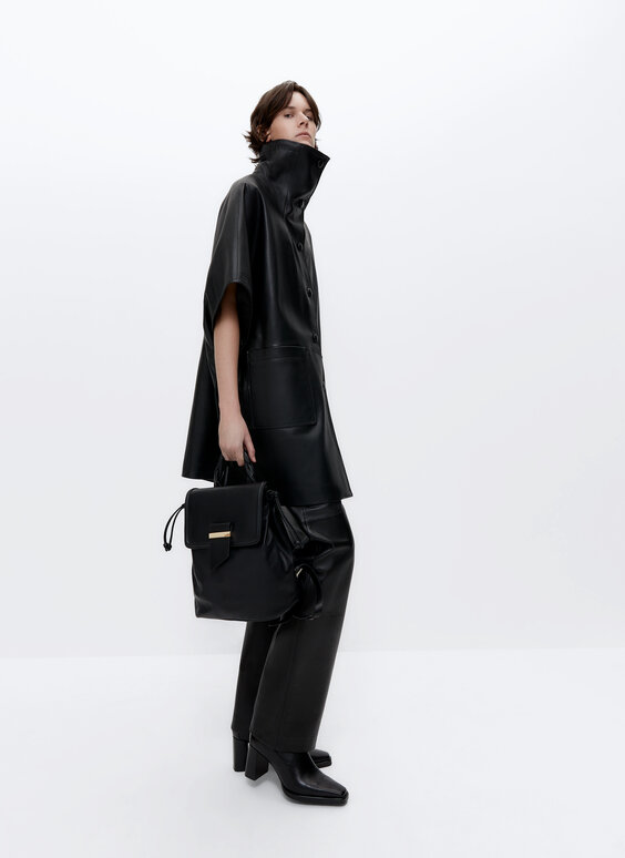 Leather poncho with pockets