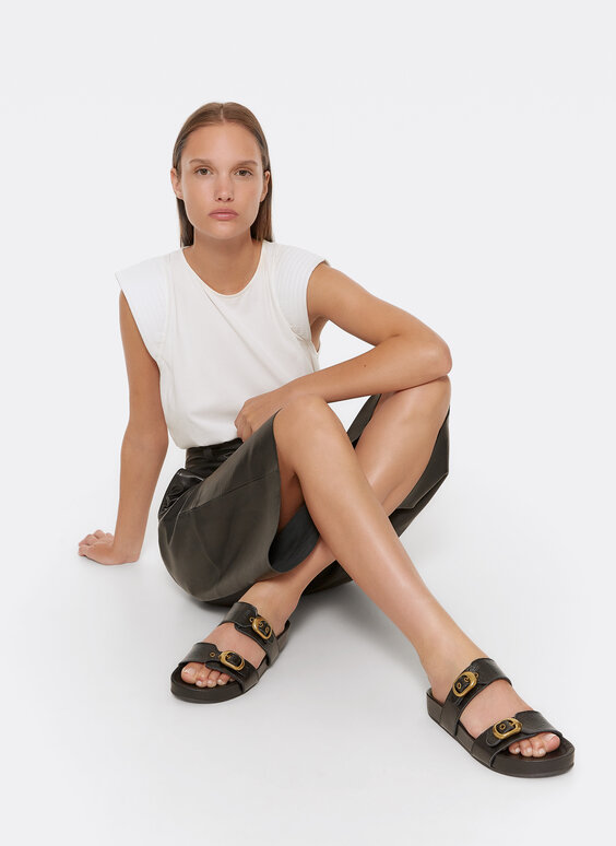 Embossed flat leather sandals