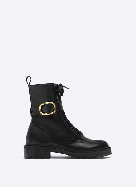 Flat leather ankle boots with buckle