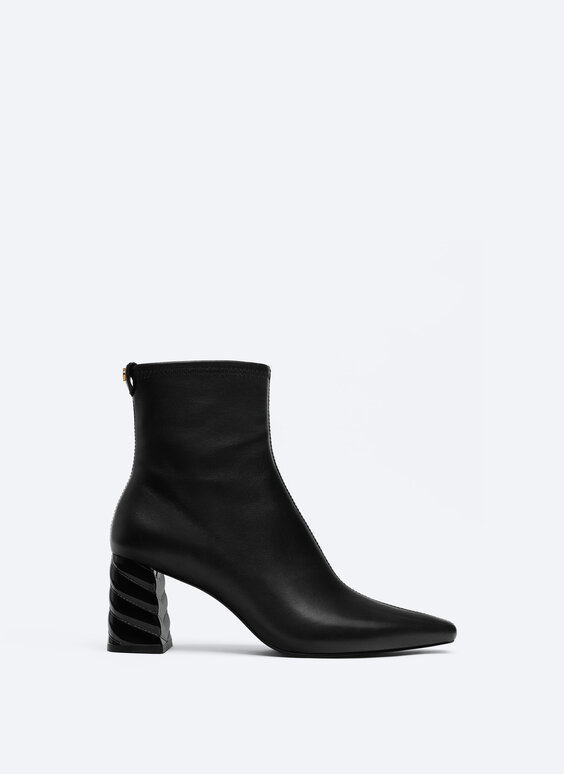 Leather ankle boots with raised detail on the heel