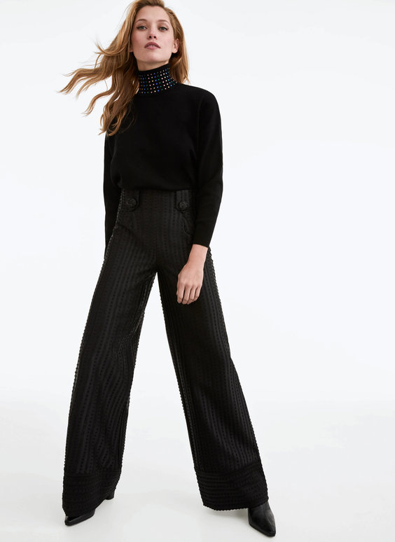 Trousers with embellished button