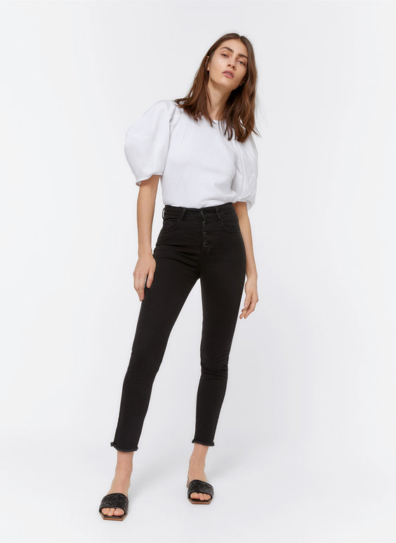 Trousers with metal buttons