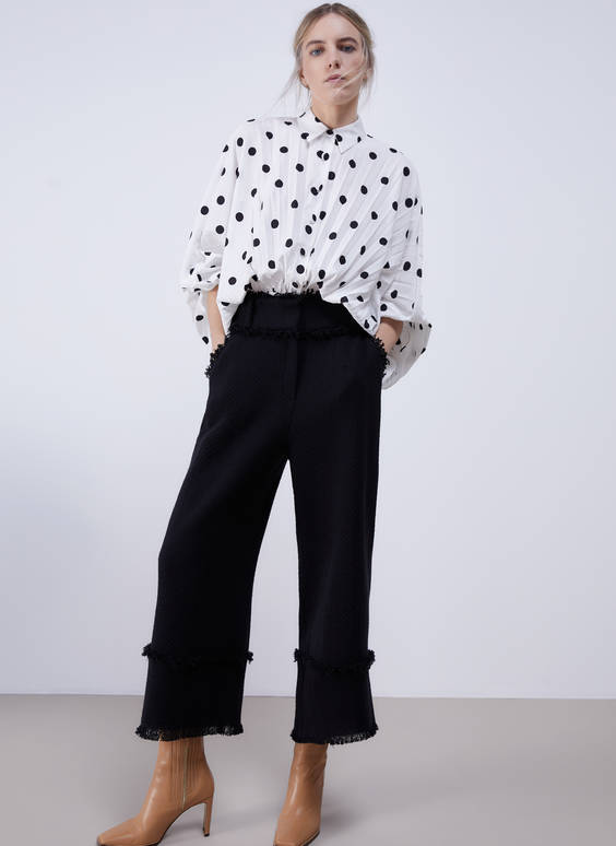 Frayed cropped trousers
