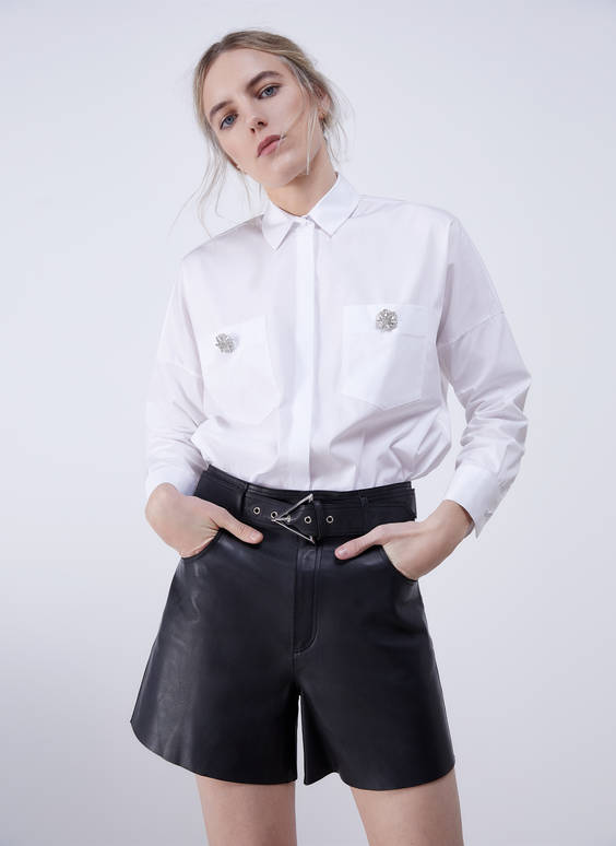 Shirt with a gem button