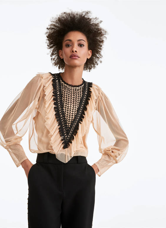Semi-sheer top with a ruffled front