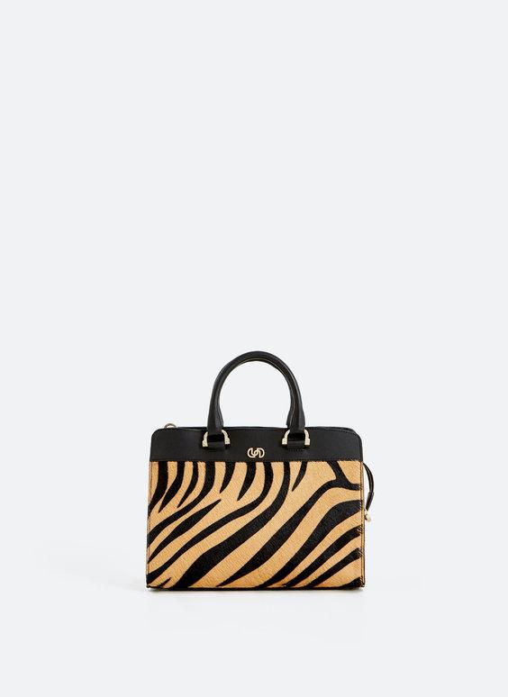 Kontrastná kožená bowlingová taška.
