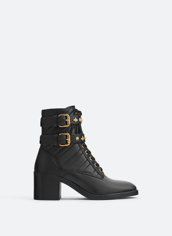 Quilted leather ankle boots with detachable buckles