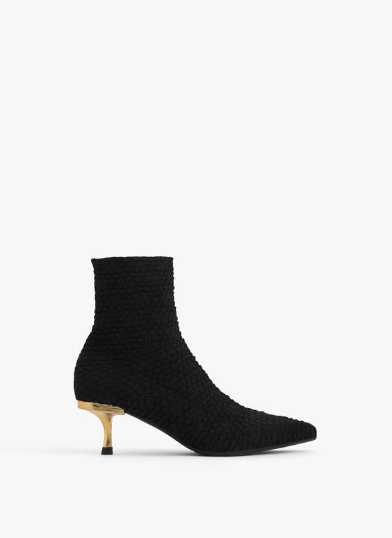 Knit ankle boots with gold heel